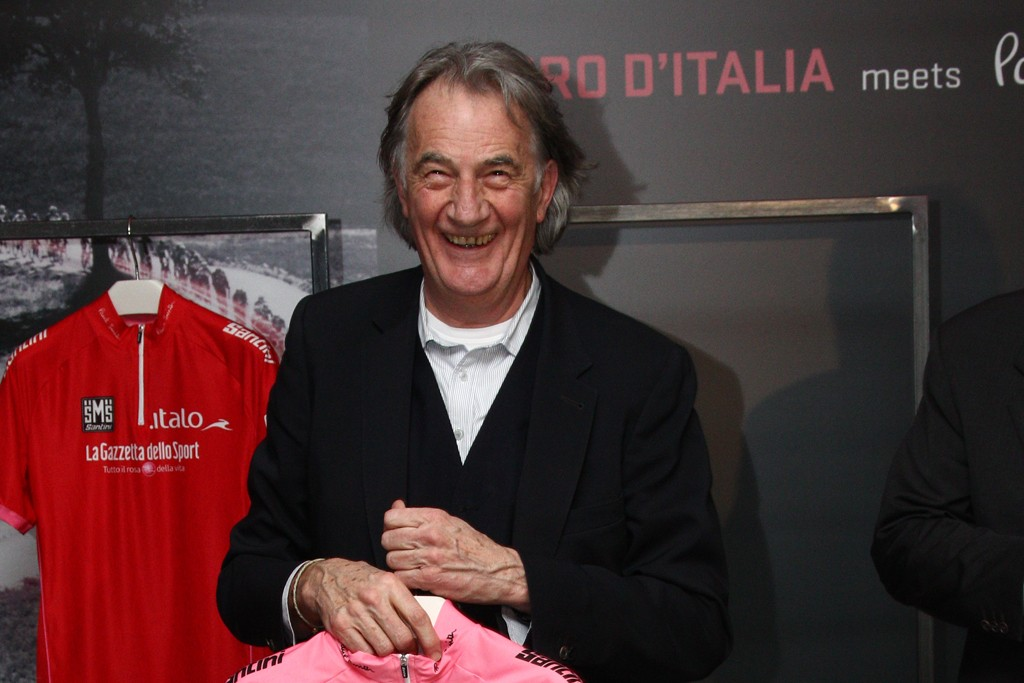 Sir Paul Smith holding a jersey he created for the 96th edition of the annual Giro d'Italia race.
