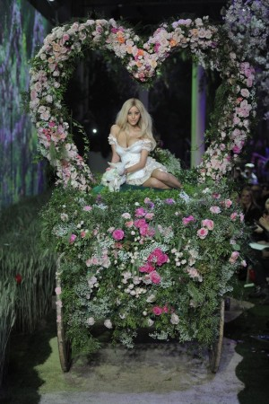 Zahia Dehar took the bow for her couture show on a flower-festooned carriage.