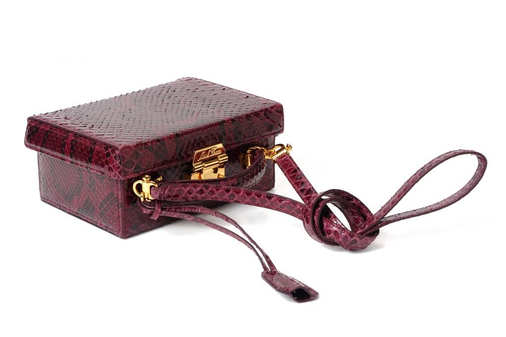 "A Mark Cross plum python ""Grace"" box bag."
