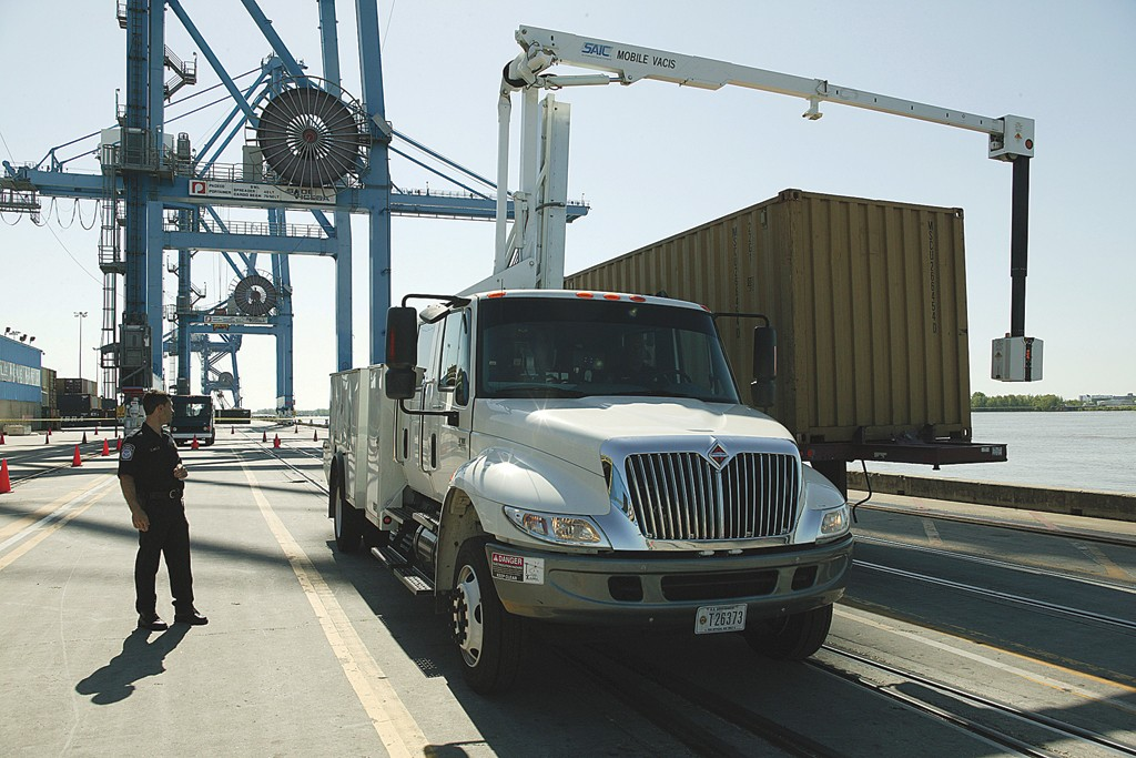 CBP officers with a mobile truck x-ray a seaport container for contraband.