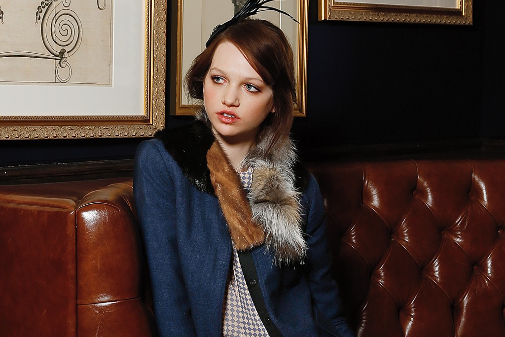 Gryphon's linen and wool jacket with fox- and mink-fur collar, Zimmermann's rayon blouse and Timo Weiland's wool trousers. Bijou Van Ness fascinator; Glam Rock Watches watch; Carolina Amato gloves; Raina belt; Pretty Ballerina slippers.
