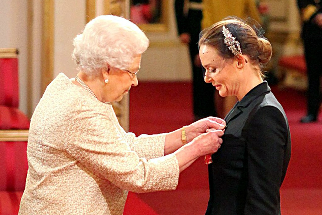 Stella McCartney receiving her Officer of the British Empire medal from Queen Elizabeth II at Buckingham Palace in London.