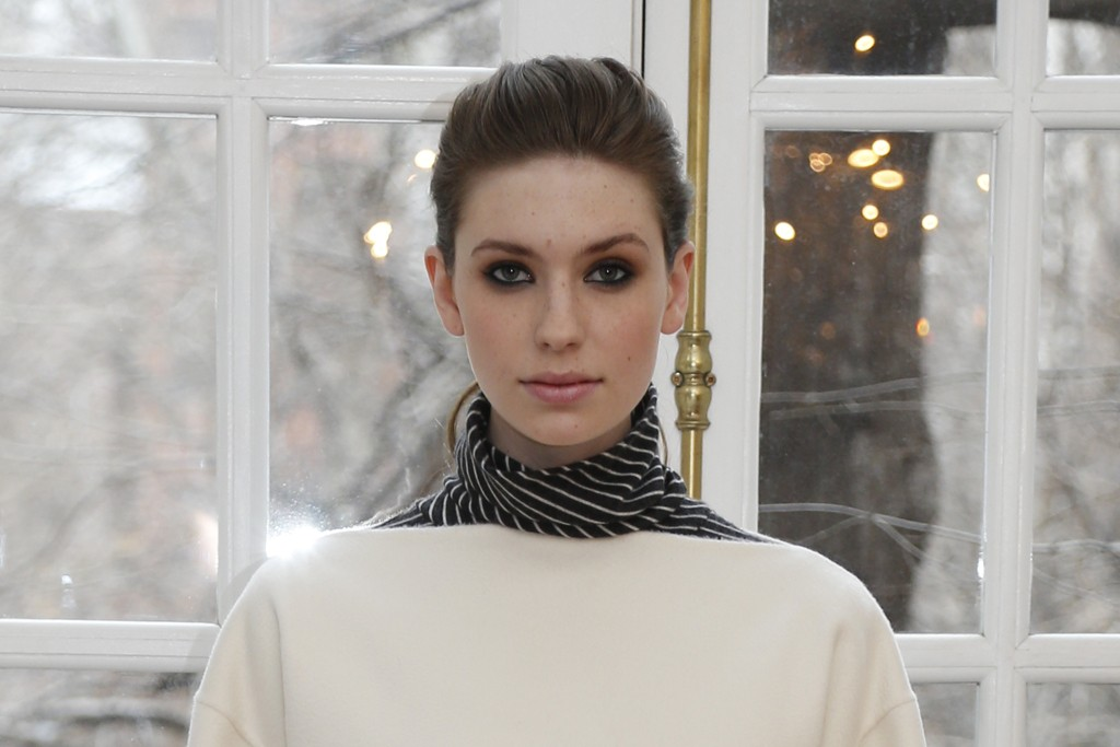 White double-faced cashmere pullover, cashmere turtleneck top and gray windowpane cashmere wide-leg pants.