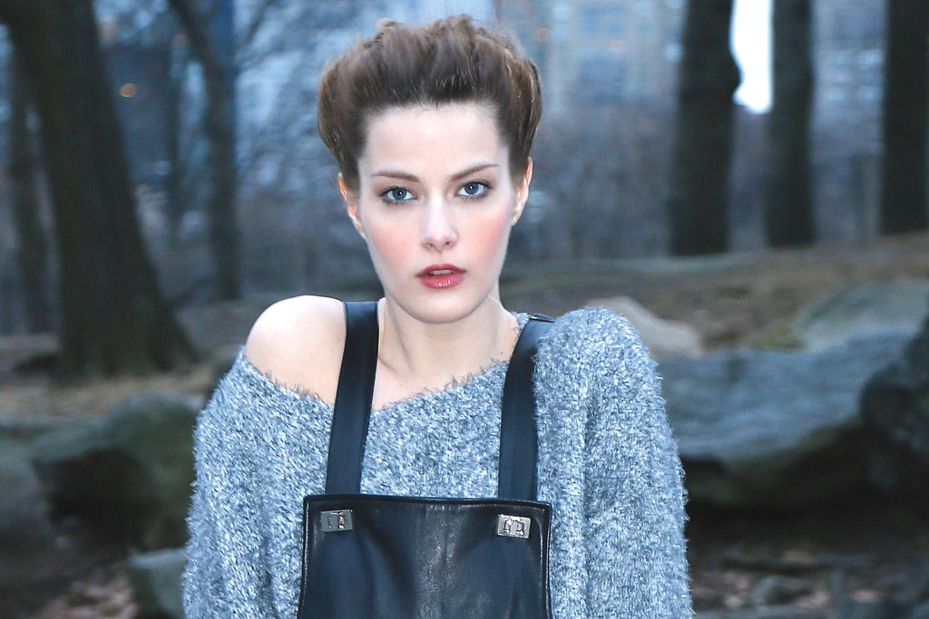 Elizabeth and James' leather overalls, polyester sweater and patent leather boots; Shourouk bracelet.