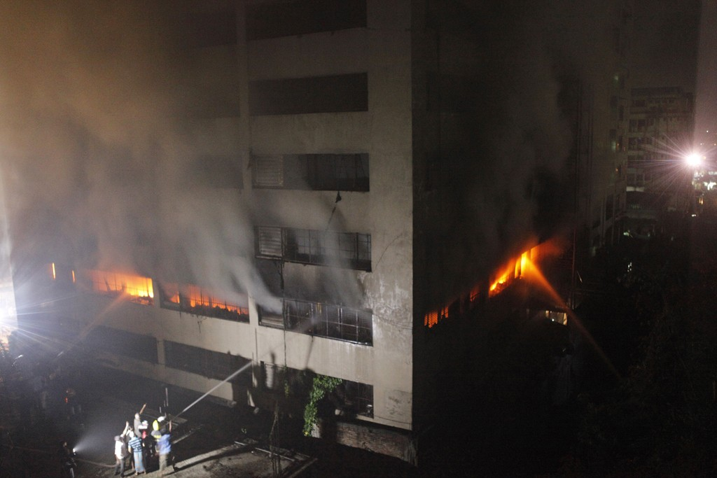 Bangladeshi firefighters attempt to extinguish a blaze at a garment factory in Dhaka.