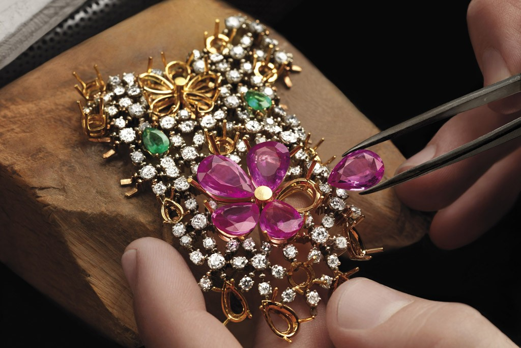 A worker places a jewel at Bulgari's atelier.