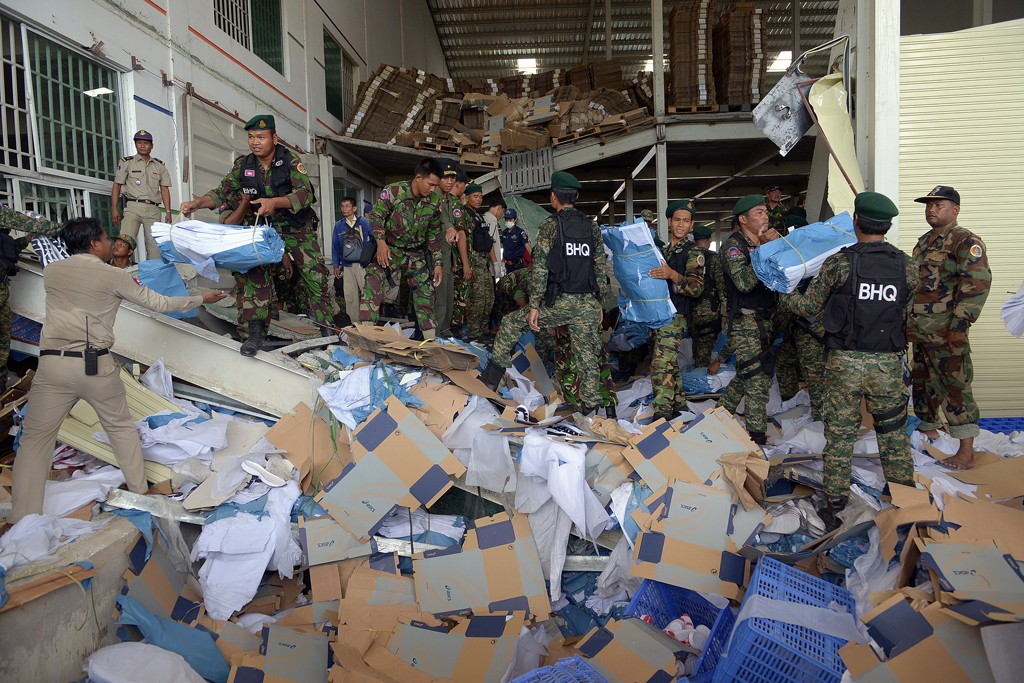 Cambodian soldiers move debris after the factory collapse outside Phnom Penh.
