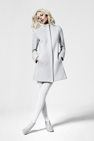 Aline Weber in a Courrèges coat with magnet fasteners, priced at 299 euros to $391 at current exchange.