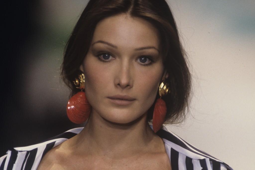 Carla Bruni walking in the Oscar de la Renta spring 1993 show in Paris.