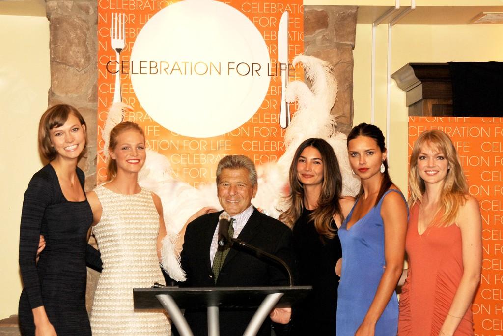 Ed Razek (center) with Victoria's Secret Angels Karlie Kloss, Erin Heatherton, Lily Aldridge and Lindsay Ellingson.