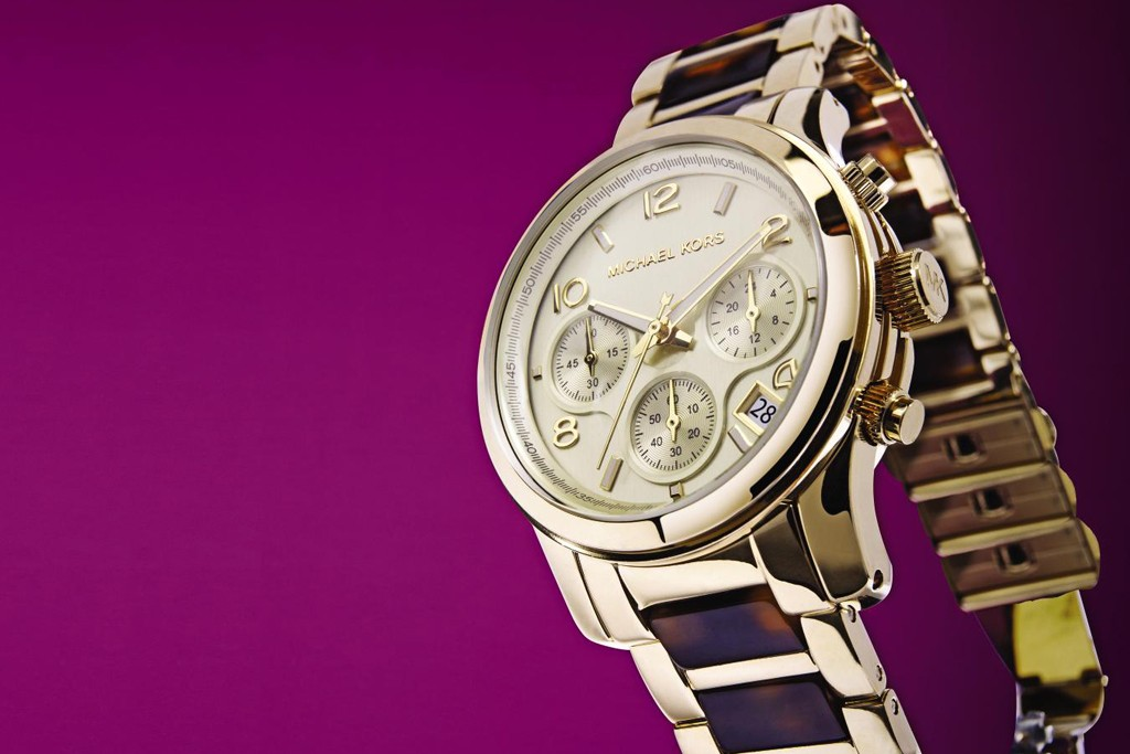 A Michael Kors tortoise and gold-tone chronograph watch.