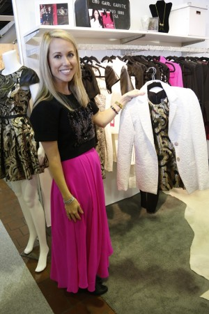 Hunter Bell shows one of her Hunter Dixon by Hunter Bell designs.