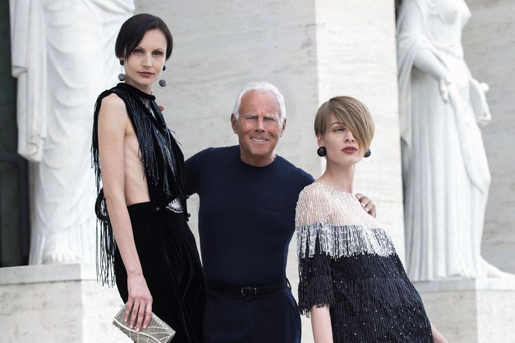 Giorgio Armani with models in his designs.