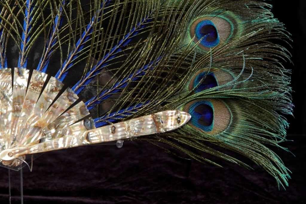 A handcrafted fan of peacock plumes from La Maison Duvelleroy.