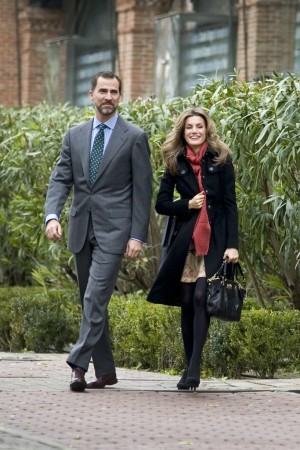 Prince Felipe of Asturias with his wife, Princess Letizia, who is carrying a Coach Madison satchel.