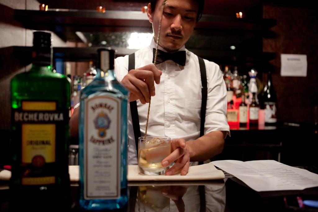 Shingo Gokan behind the bar at King & Canvas.