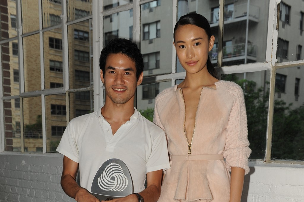 Joseph Altuzarra and a model wearing the winning design.