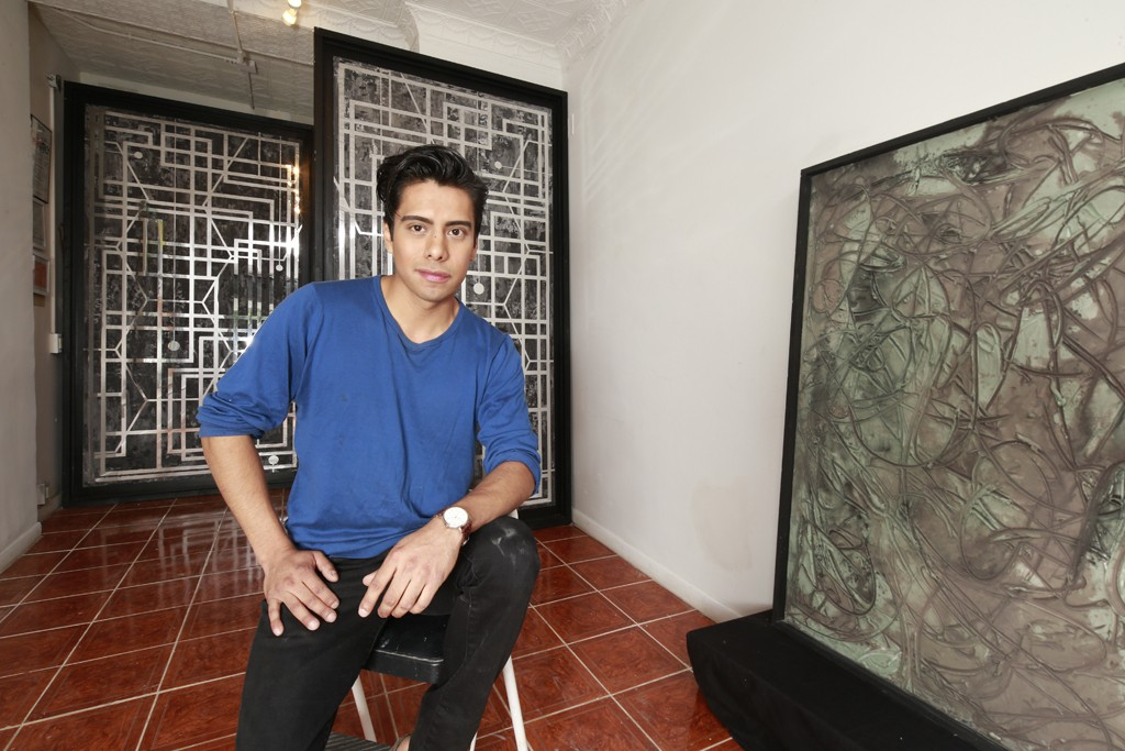 """Jonathan Chánduví in his atelier with one of his pieces from the diptych """"The Eleventh Hour."""""""