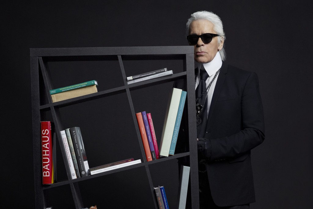 Karl Lagerfeld poses with an angular bookcase from French retail giant But.