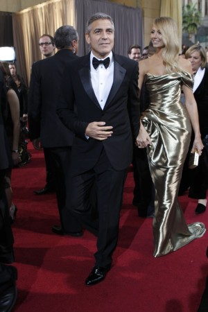 George Clooney in Giorgio Armani with Stacy Keibler in Marchesa.