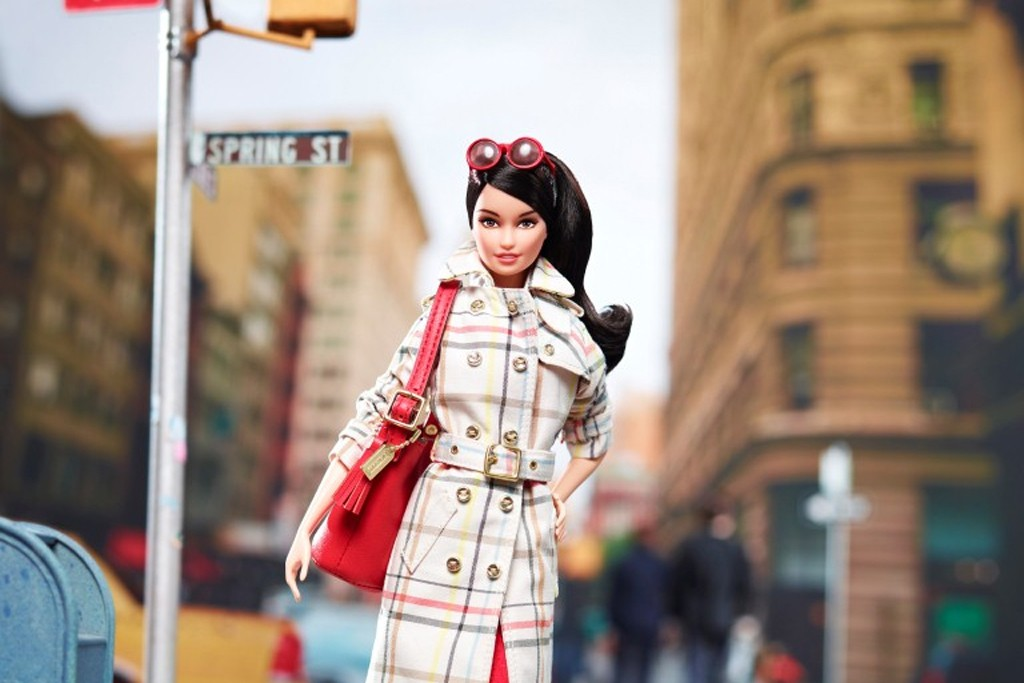A look at the special edition Coach Barbie doll.