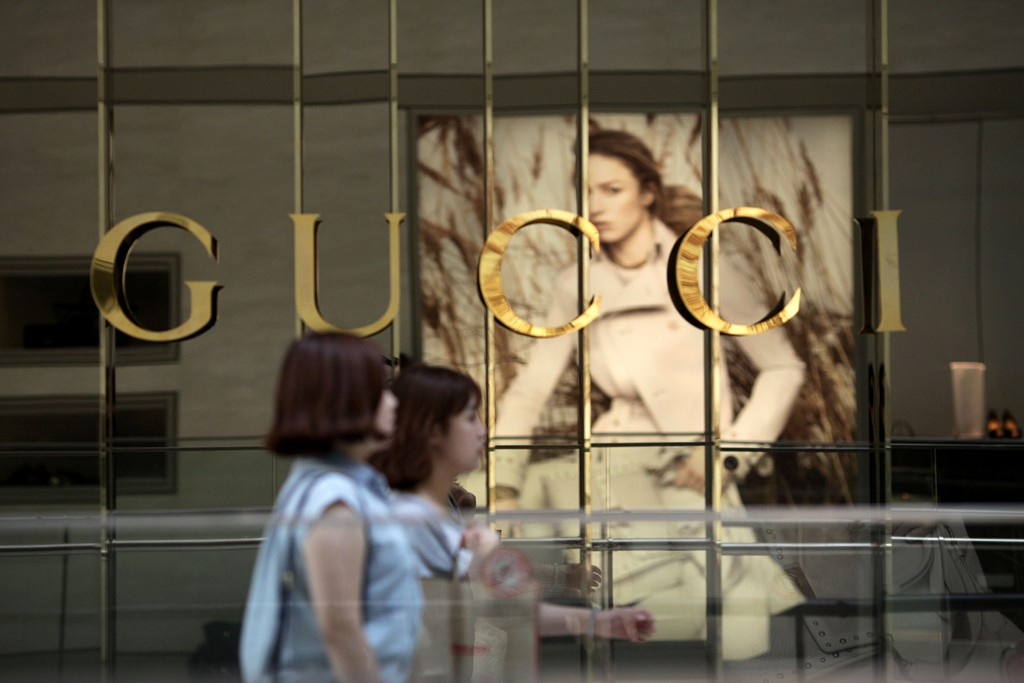 Pedestrians pass a Gucci store in Seoul, South Korea.