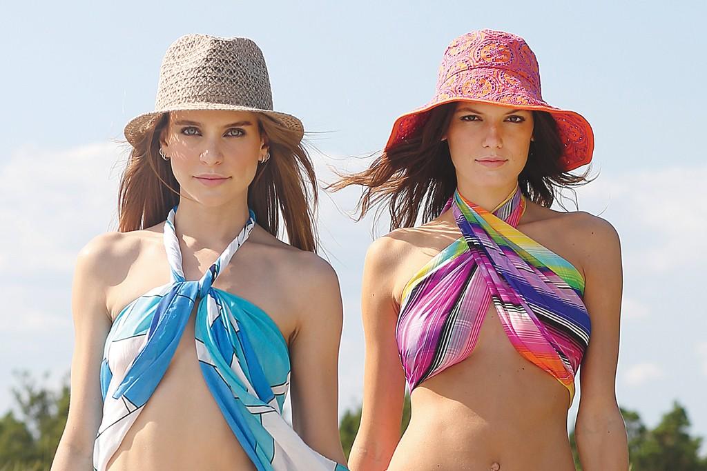 From Left: Echo's Regatta pareo worn as cover-up; Cozumel medallion string bottom; hemp fedora; Serape stripe oversize square worn as cover-up; Surf Board City scarf worn as sarong; string bikini bottom; eyelet bucket hat.