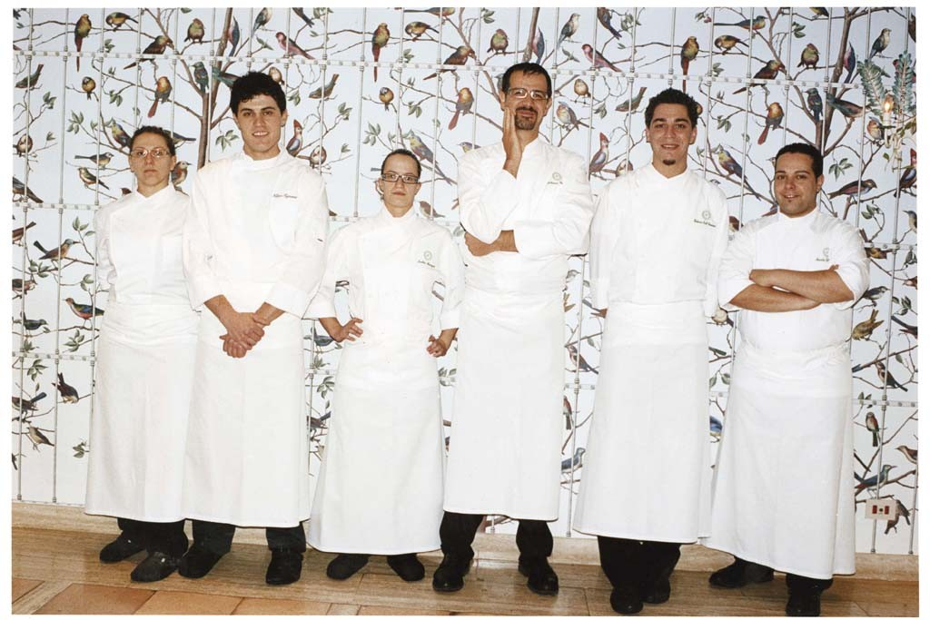 Chef Antonio Guida, center, and his kitchen staff at Hotel Il Pellicano in 2009.