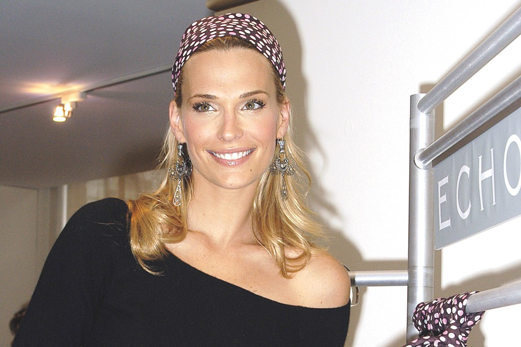 Molly Sims collaborated with Echo on a scarf designed to benefit the Ovarian Cancer Research Fund in 2003.
