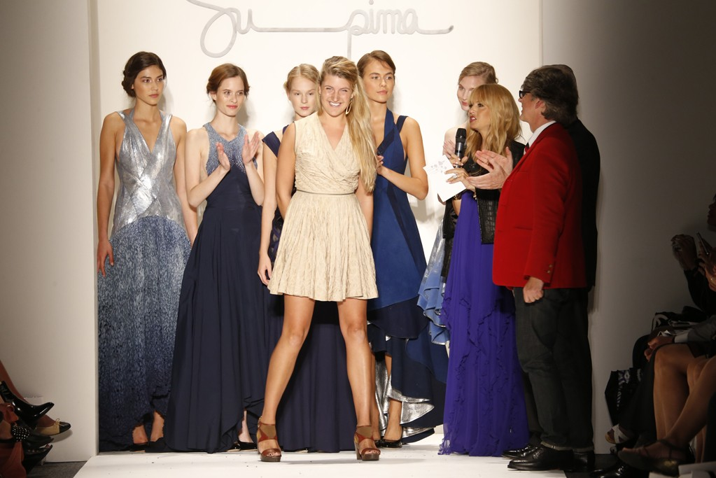 Morgan Selin takes a bow with her models.