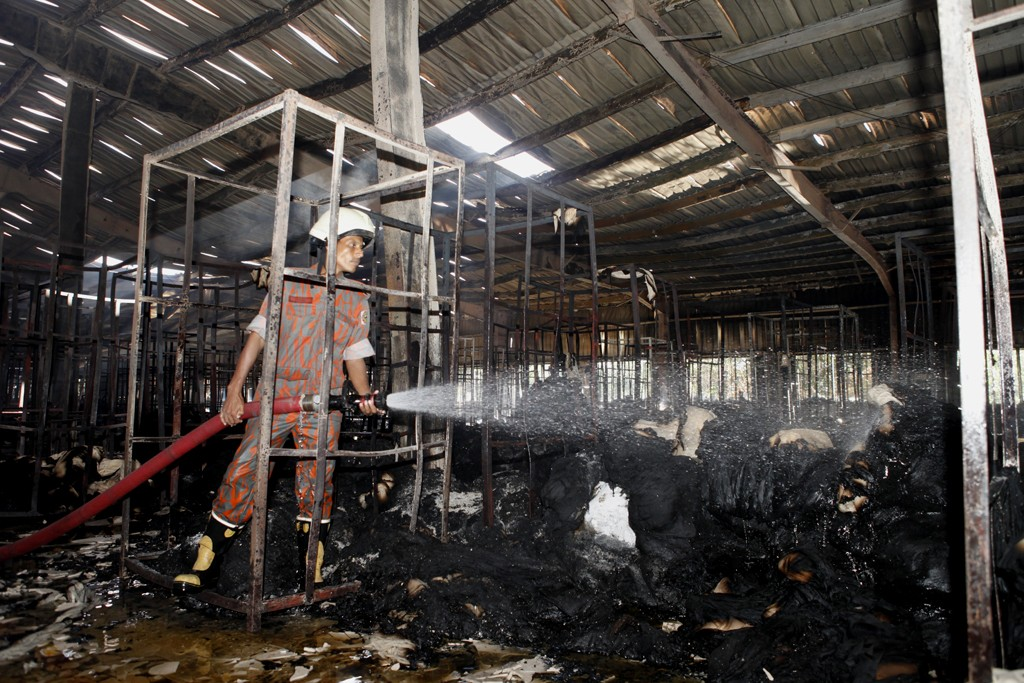 The remnants of the latest Bangladesh factory fire, which killed nine.