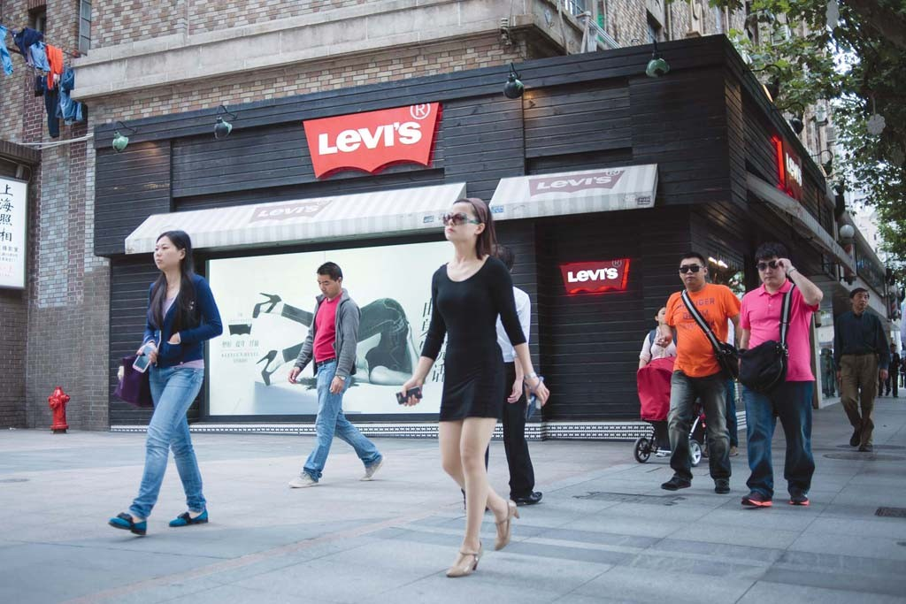 Shoppers peruse stores on West Nanjing Road in Shanghai.