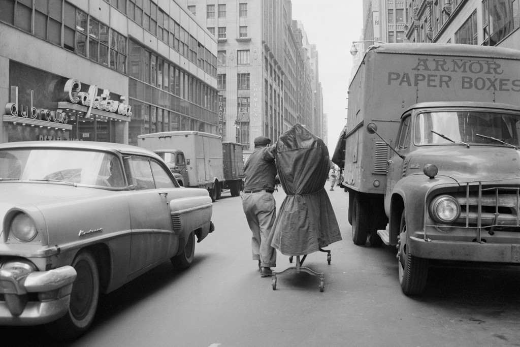 A Garment District worker navigates the traffic back in the days of hot pastrami.