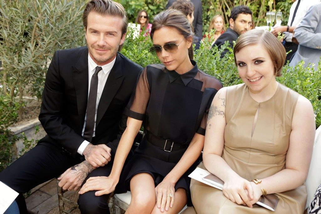 David and Victoria Beckham with Lena Dunham in Reed Krakoff.