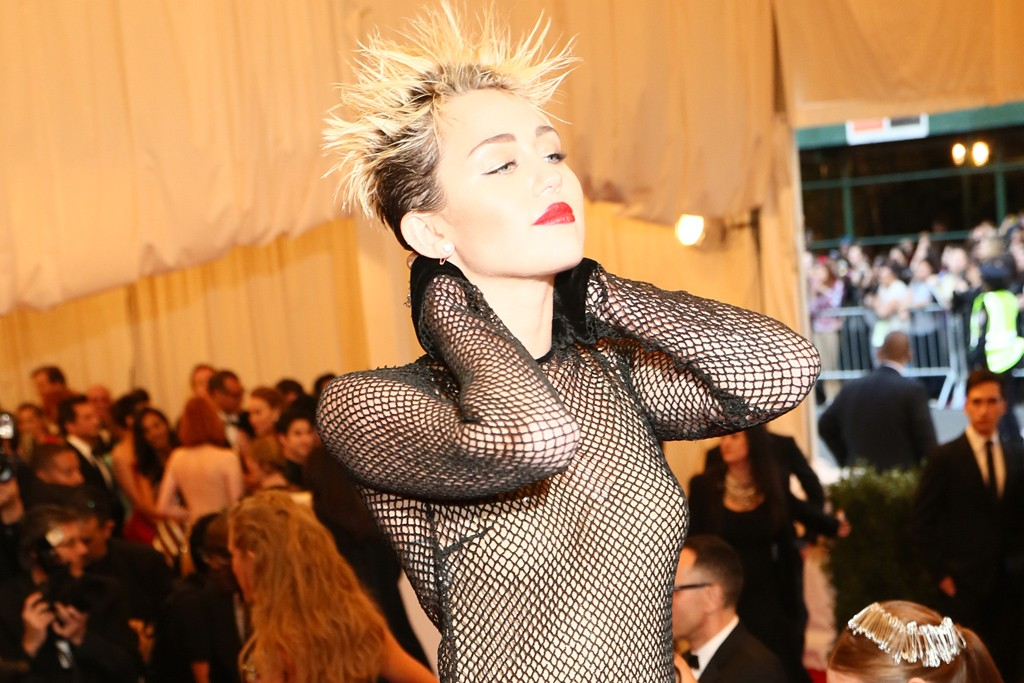 Miley Cyrus in Marc Jacobs at the Costume Institute benefit.