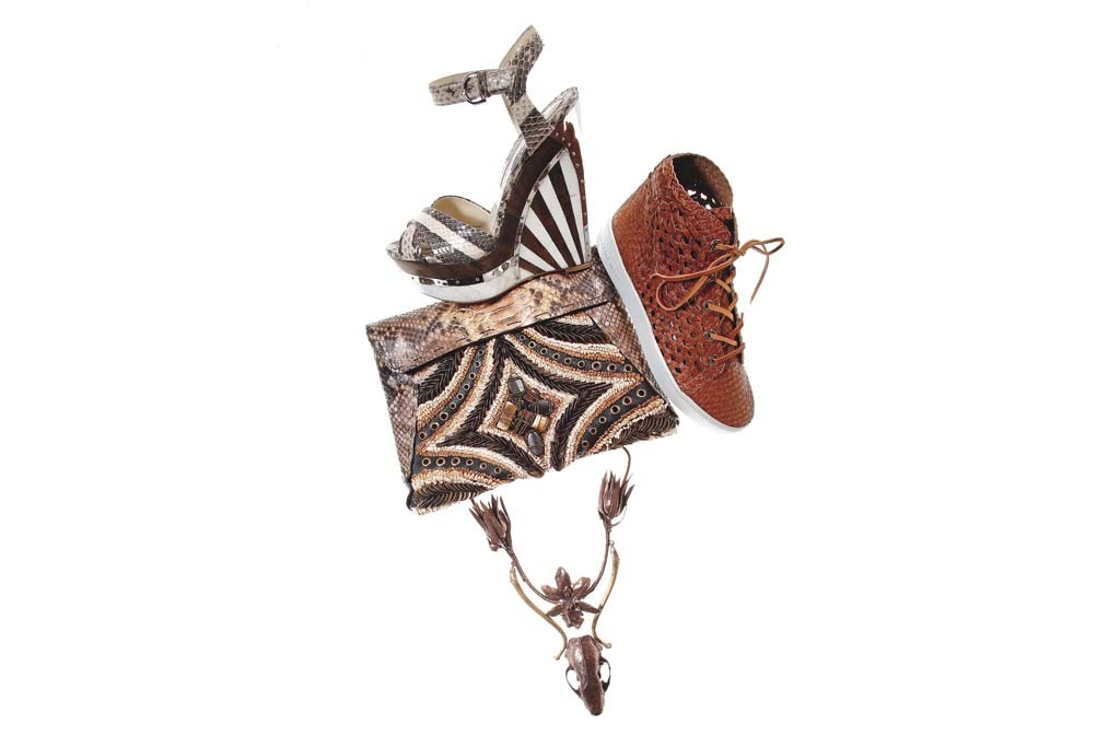 Brian Atwood's python shoe with a ceramic and wood wedge; Michael Kors' leather sneaker; Donna Karan's python clutch; Proenza Schouler's animal skull and thistles in copper necklace.