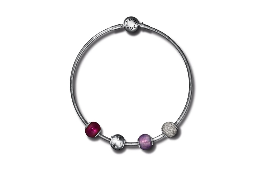 A styled bracelet comprised of beads from Pandora's Essence collection.