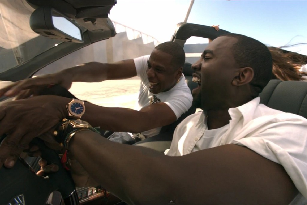 """Jay Z shows off a Hublot Classic Fusion (and Kanye West wears a Rolex) in this still from the """"Otis"""" video."""