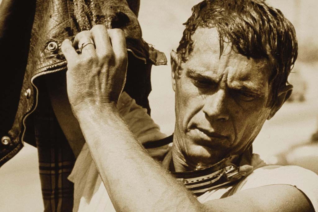 Actor Steve McQueen during a motorcycle race in the Mojave Desert in June, 1963.