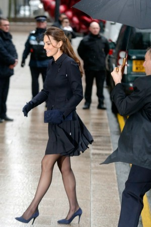The Duchess of Cambridge in a Max Mara jacket and Orla Kiely skirt.