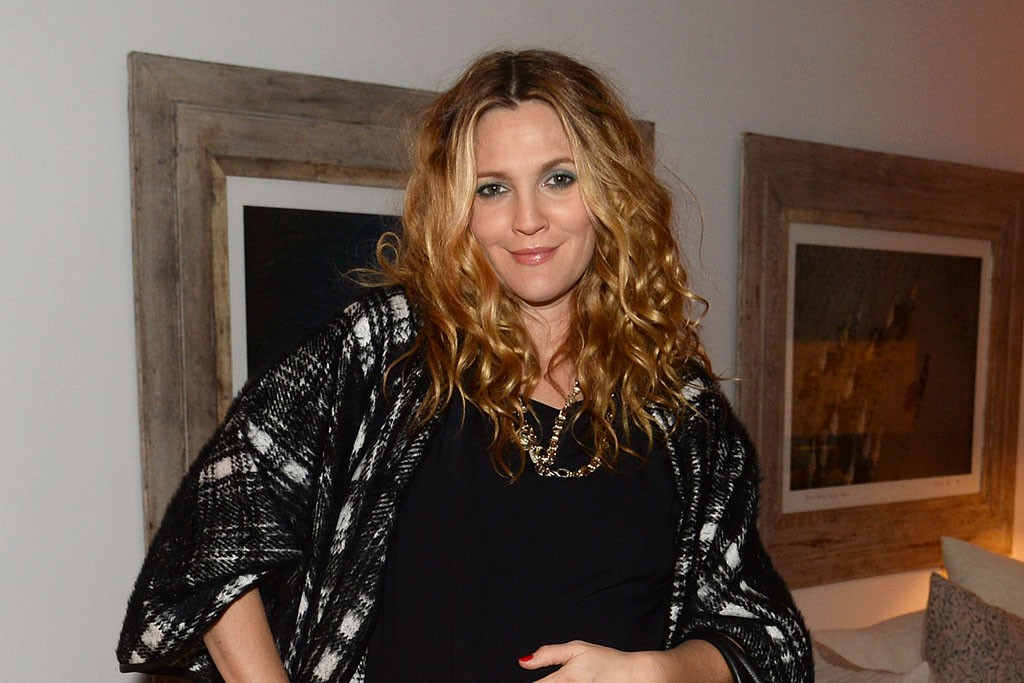 Drew Barrymore in a Coach cape and bag.