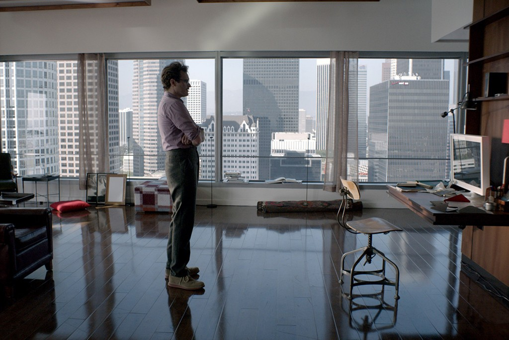 Joaquin Phoenix, in high-waisted pants, stars in the new Spike Jonze joint, Her.
