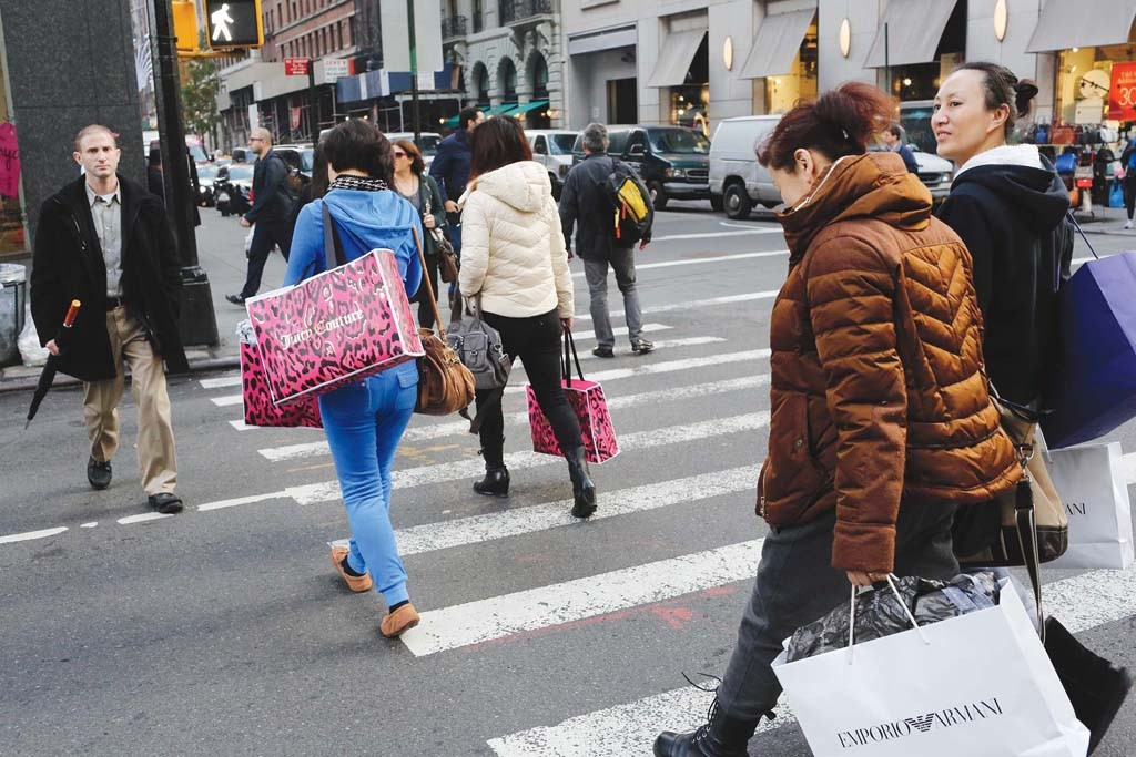 Shoppers crossing Madison Avenue at 60th Street.