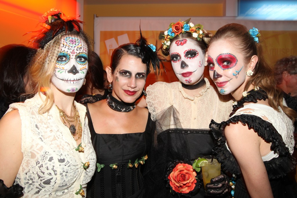 Models, including art curator Sabrina Wirth, from El Museo del Barrio's Junior Council in Day of the Dead garb designed by artist and Vox Profero CCO Susan Jaramillo, center left.