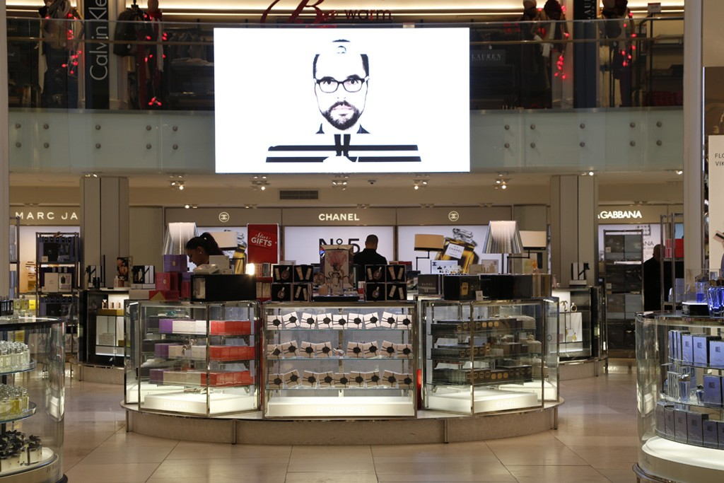 An LED screen overlooks the fragrance department, as seen from the 34th Street Memorial Door Entrance.