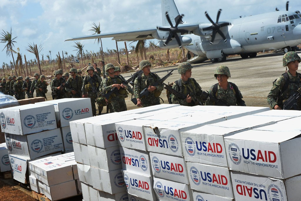 Philippine soldiers operating out of Guiuan Airport as a forward air base for relief supplies after Typhoon Haiyan.