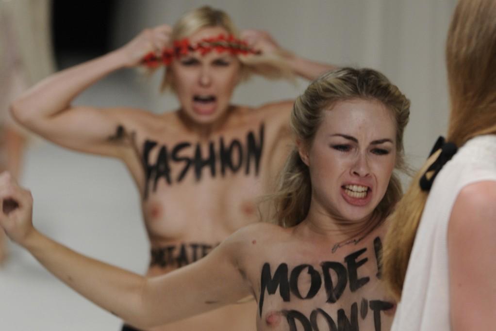 Femen activists invade the runway at Nina Ricci
