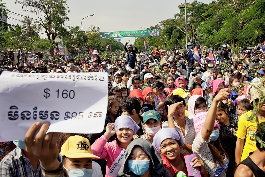 Mass demonstrations kicked off in Cambodia after the government said the minimum wage in the garment sector will be raised to $95 a month, an amount that falls short of demands by workers.