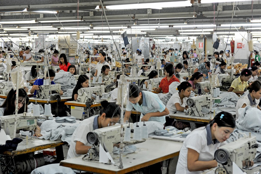 Workers sew clothes at Dragon State Ltd. factory at Pyin-Ma-bin Industrial Estate in Yangon.