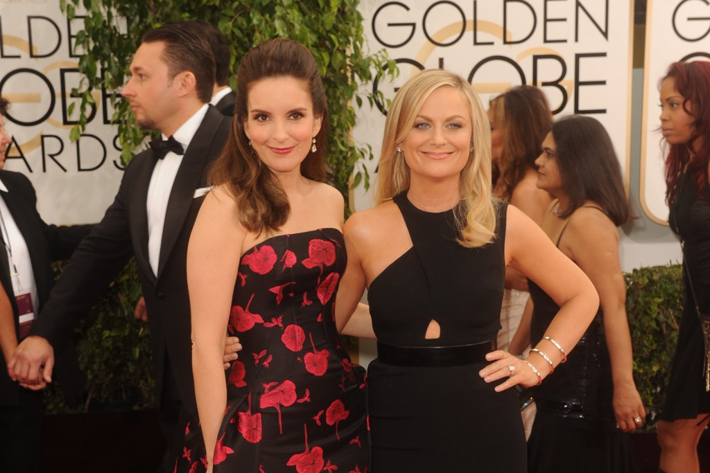 Tina Fey in Carolina Herrera with Amy Poehler in Stella McCartney.